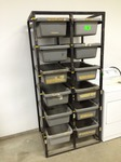 "Storage Unit with 12 drawer tubs - measures: 36"" W x 26 D x 78"" H"