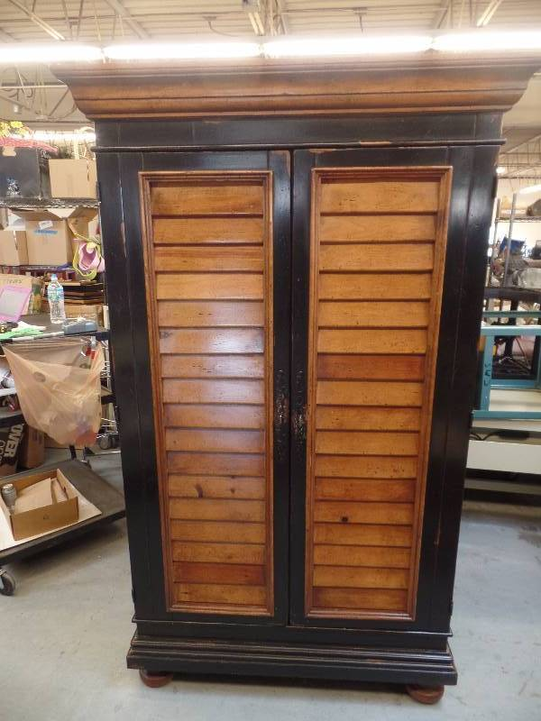 Media Cabinet. All Wood Construction. Measures 47 X 23 X 78. Made By  Chez Del Furniture. Interior Has 3 Sections. No Interior Shelves Included.