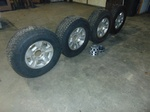 Set of Rims And Tires Off From A 2009 3/4 Ton Chevy 2500 with Center Caps