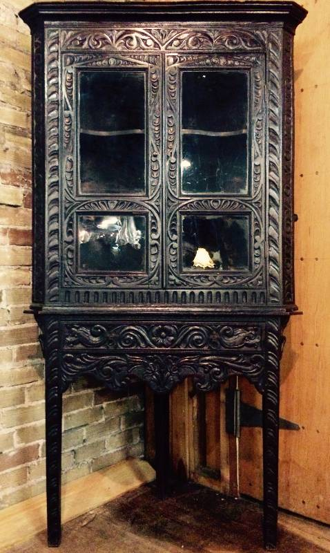 An ebonized and heavily carved oak corner cabinet and stand with glazed  doors. In excellent condition.English circa 1880. Unique piece. - Stillwater Antique English Furniture Auction No Reserve In