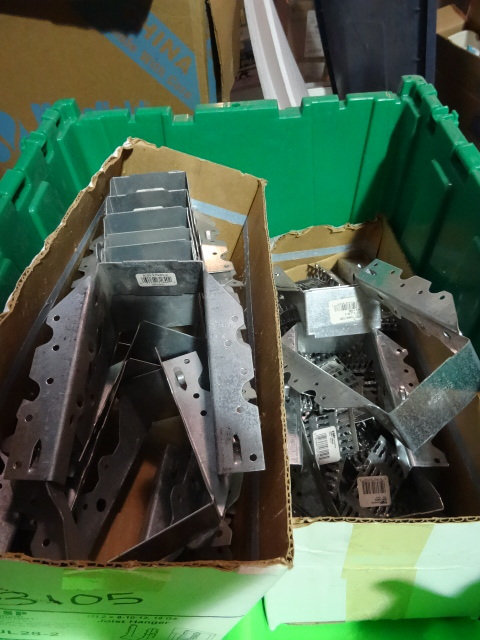 NEW ENTIRE BIN Construction Fasteners incl approx 20 Joist Hangers 2x8/10/12; approx 50 Truss Plate Fasteners 3.5 x 1.5 in; and approx 50 Hurricane Ties 1.5 x 6.5 in. GREEN BIN NOT INCLUDED