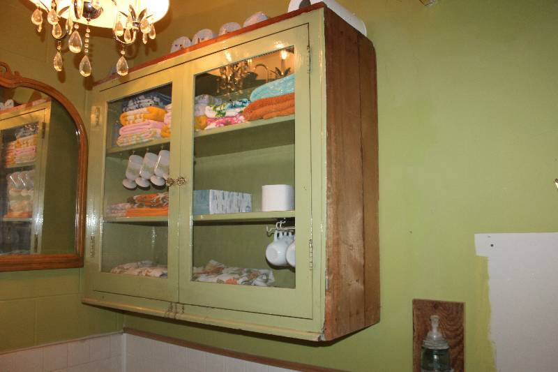 The excellent vintage glass front wall cabinet