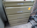 4 drawer metal cabinet. Has divider...