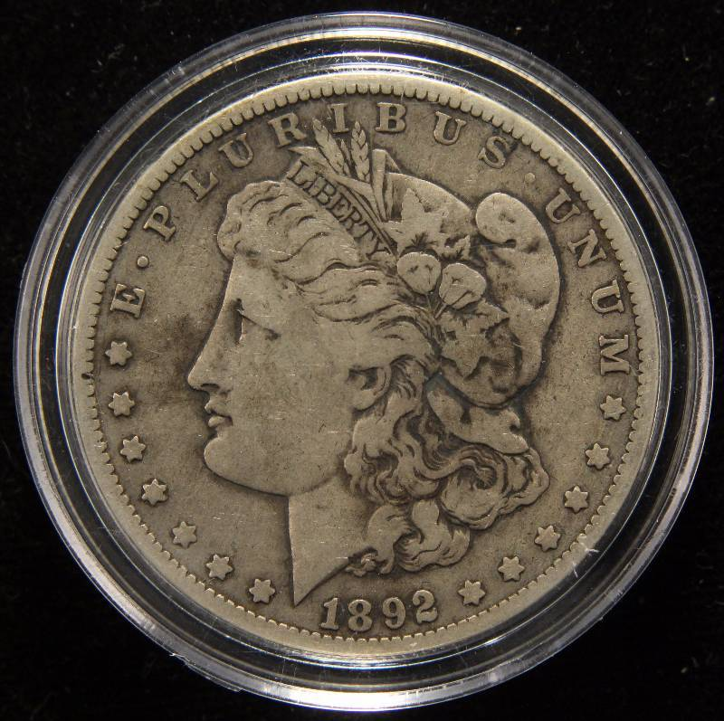 1892-O MORGAN SILVER DOLLAR FINE IN AIRTITE HOLDER