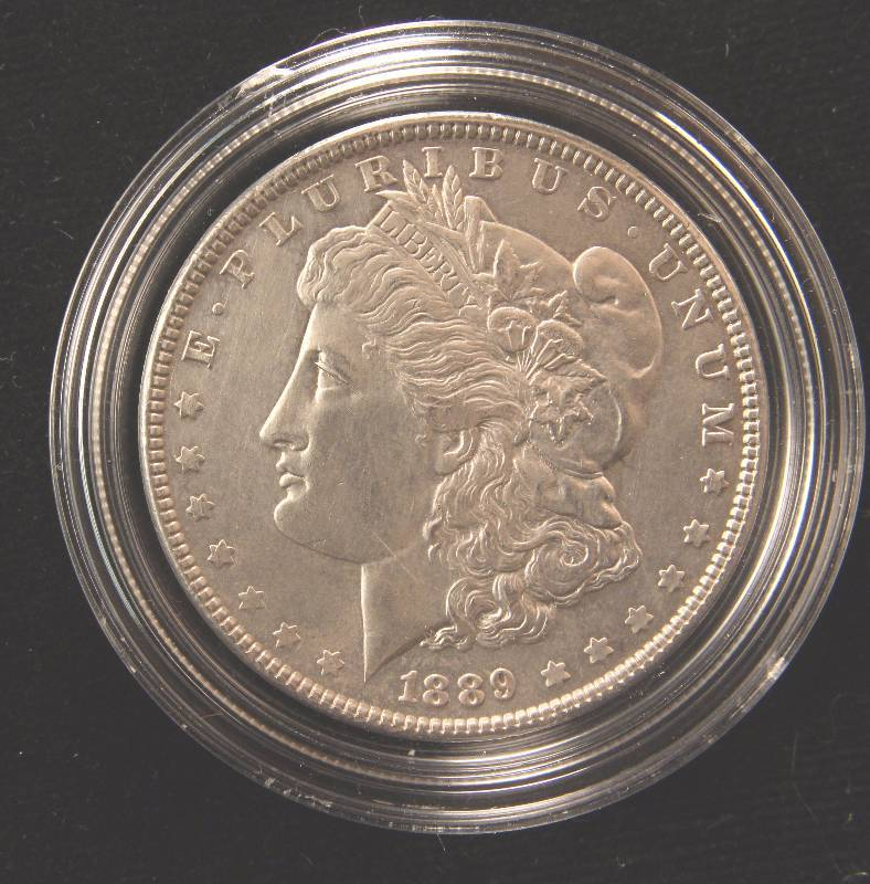 1889 MORGAN SILVER DOLLAR UNC CLEANED IN AIRTITE HOLDER