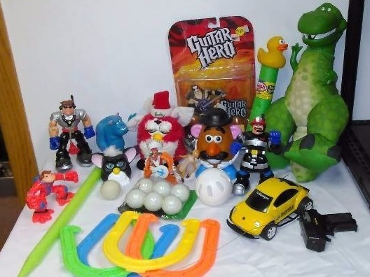 Toy Figurine Lot, Monster Inc., Furby?s, Mr. Potato Head, Guitar Hero, VW Beatle and more
