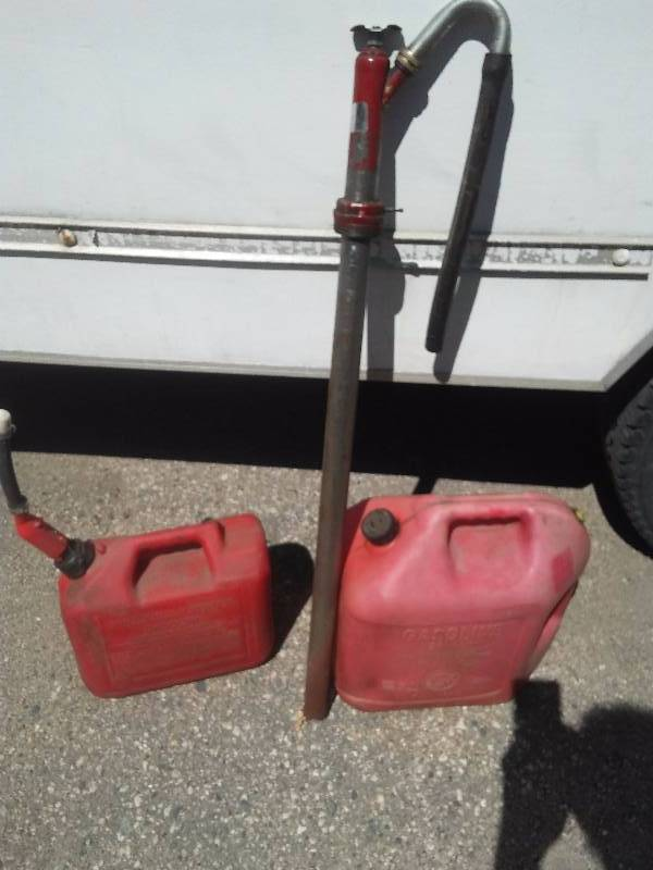 Gas Cans and Oil Pump Dispenser, 5 gal and 2 � gal.