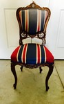 ANTIQUE CARVED DINING ROOM CHAIR WITH STRIPED UPHOLSTERY
