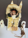 FUR WRAPPED PAPOOSE IN WOOD, FUR AND DOESKIN CRADLEBOARD