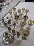 COLLECTION OF SILVER-PLATE CHALICES AND PEWTER CANDLESTICK HOLDERS