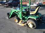 "John Deere 455 with Front-End Attachment, Bucket, 60"" Mower Deck"