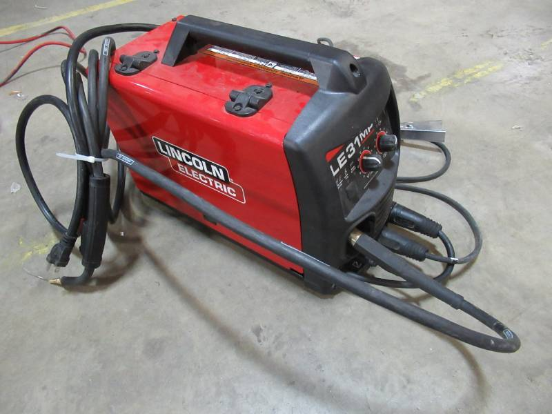 Lincoln Electric 140 Amp Le31mp Multi Process Stick Mig Tig Welder With Magnum Pro 100l Gun Mig And Flux Cored Wire Single Phase 120v K3461 1 Mn Home Outlet Burnsville Auction 74 K Bid