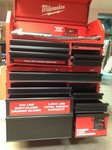 Milwaukee 46 in. 16-Drawer Steel Tool Chest and Rolling Cabinet Set, Textured Red and Black Matte whit damage one door need help to open