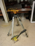 SURVEYING HEAD WITH STAND AND MEASURING WHEEL
