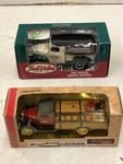 (1) 1931 Hawkeye Flatbed & (1) 1947 Dodge Canopy Coin Banks