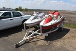 Pair of  Arctic Cat Tigershark Jet Skies w/ Tandem Trailer