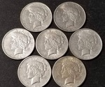 GROUP OF 7 US PEACE SILVER DOLLARS VF-AU