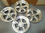 4 American Racing Torque Thruster II Polished Aluminum Rims.