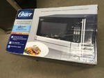Oster 1.6 cu. ft. 1100-Watt Countertop Microwave with Inverter Sensor Cook Technology in Stainless Steel in good condition