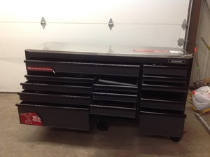 Husky Heavy-Duty 72 in. W 15-Drawer, Deep Tool Chest Mobile Workbench in Matte Black with Stainless Steel Top and Dual Locks not used whit small damage some door don't  open review the photos
