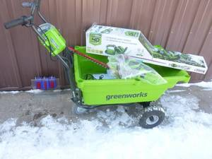Greenworx 40 volt powered dump yard cart with 40 volt hedge trimmer. Includes battery & charger. Tested & works. As shown.