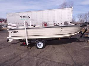 1980 Sylvan Sea Monster 16ft Boat with 1980 Johnson 35 hp 2 stroke outboard motor and 1979 Trail- R- Craft boat trailer