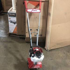Mantis 25cc 4-Cycle Plus Gas Mini Tiller in working conditions