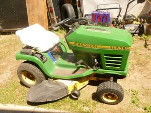 1996 John Deere STX38. Tested & works. May need carb adjustment for high speed. Seat is cracked. Very nice hood. May also need battery. As shown.