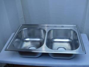 Elkay 33-in x 22-in Satin Double Equal Bowl Drop-In 4-Hole Residential Kitchen Sink---Slight damage on upper left corner see pics---
