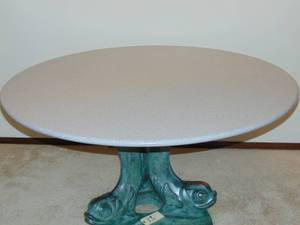 Magnificent Solid Surface top table with Green Bronze Fish Base in very good condition