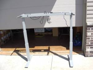 Perfect for the home office. Power height adjustable legs for sitting or standing desk/table. Retails $1250 Free SpeeDee shipping on this item.