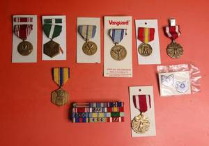 10 piece set of military medals/medallions