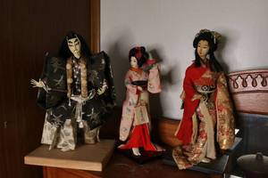 Lot of three Japanese dolls in traditional dress