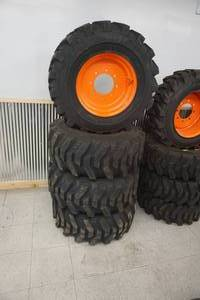 Brand New Set of - 4 Camso Skid Loader Tires & Rims RESERVE IS $1200.00