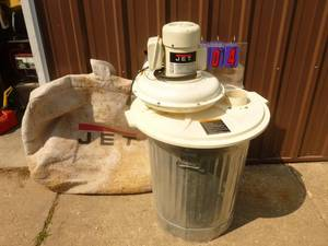 Jet dust collector with bag. 110 volt. Used condition. Tested & works. As shown.