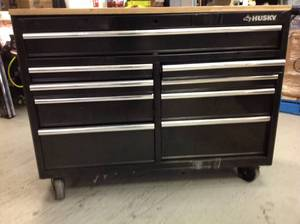 Husky 52 in. W 9-Drawer, Deep Tool Chest Mobile Workbench in Gloss Black with Hardwood Top have some scrtachs and not switch lock