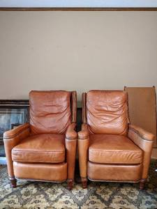 Two Brown Hooker Leather Reclining Chairs With Ornate Woodworking