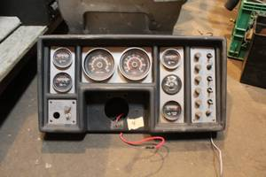 Old boat dash with switches and gauges for a Mercruiser.