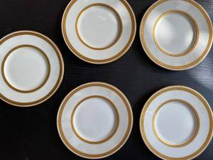 5 Tiffany & Co Saucers with gold trim