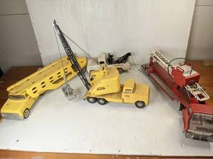 Four Vintage Metal Toy Tonka Trucks