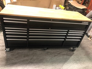 72 in. 18-Drawer Mobile Workbench with Solid Wood Top, Black by Husky not used whit scratches and dents please review the pictures