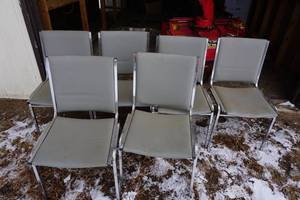 6 Grey Stackable Chairs