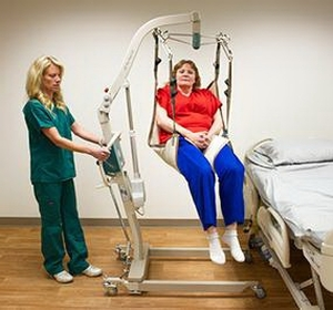 WOW MSRP $5000 MCKESSON EZ WAY Easy Way Battery Powered Electric EZ Lift 500 lb Capacity Patient Loved One Transfer Lift With SCALE & WOW 2 WORKING BATTERIES(ONE IS NEW), CHARGER & TWO SIZES OF SLINGS - EXCELLENT WORKING CONDITION!