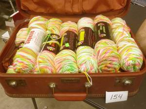 13 new skeins of yarn in suitcase...