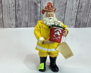 "KSA Fabriche Firefighter Santa, 11"" tall"