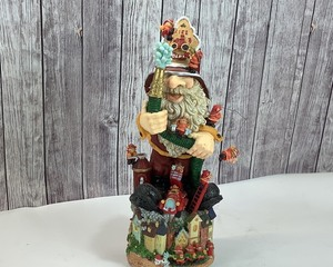 "Firefighter Santa, 16"" tall"