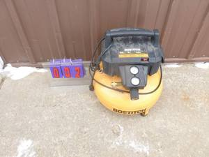 Bostich pancake air compressor. Turns on & makes a funny noise. For parts or repair. As shown.