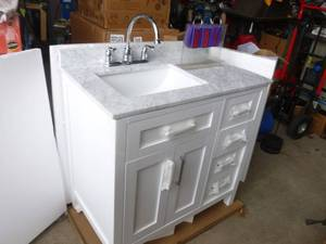 "36"" OVE Tahoe vanity with marble? Top & faucet. $1000 at Lowes. Box was opened for the 1st time to take pictures for this auction. Has a tiny chip in top. As shown. *THIS ITEM HAS A RESERVE."