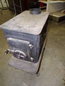 "Cast Iron Wood Stove with Decorative Sides 24""H x 24""D x 13""W"