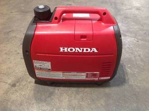 Honda 2200-Watt Recoil Start Gasoline Powered Inverter Generator with 20 Amp Outlet used in working conditions
